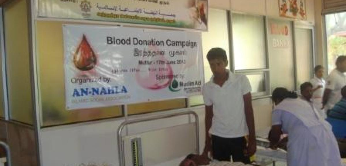 Locals donating blood at Muslim Aid Sri Lanka supported blood donation camp in Muttur, Sri Lanka