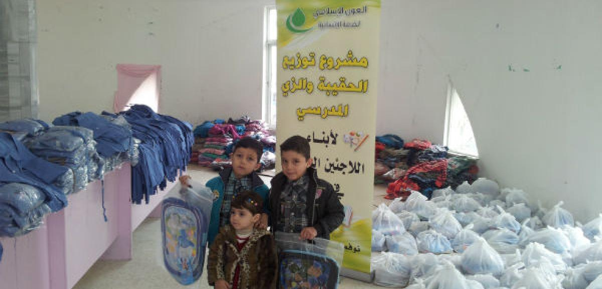 Syrian refugee children receiving educational parcels to help them go back to school