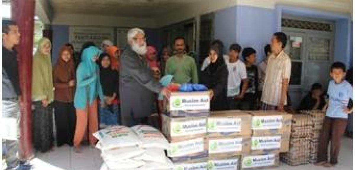 Vice Chairman of Muslim Aid, Dr Suhaib Hasan gives the Ramadan Feed the Fasting packs in the Muslim Aid Indonesia Field Office