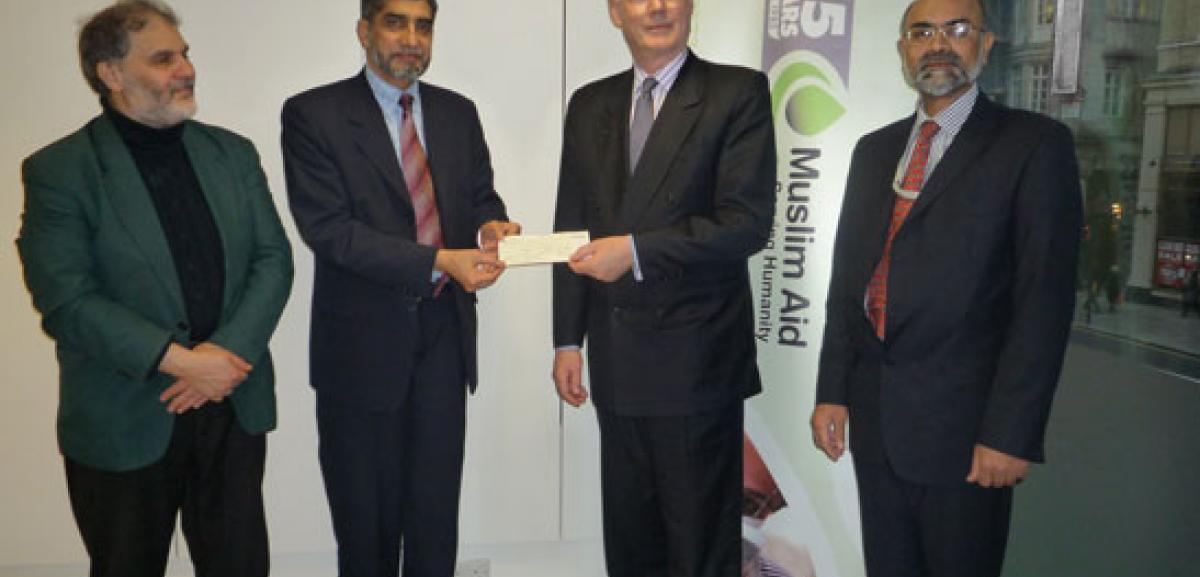 Cheque presentation: from left to right, Muslim Aid Trustee, Dr. Abdul Majid Katme; Muslim Aid Chairman, Sir Iqbal Sacranie; Agent-General for Queensland, Mr Andrew Craig and Muslim Aid CEO, Mr Syed Sharfuddin
